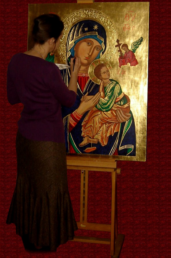 Artist at work on icon Our Lady of Perpetual Help